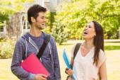 Smiling friends student standing with shoulder bag holding book — Stock Photo