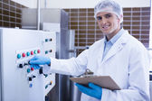 Smiling biologist using the machine — Stock Photo