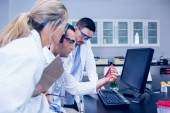 Science students working together in the lab — Stock Photo