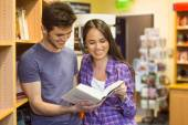 Smiling friends student reading textbook — Stock Photo