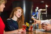 Pretty girls being served cocktails — Stock Photo