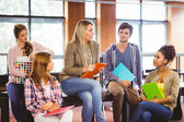 Happy students talking with their teacher — Stock Photo