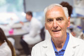 Science lecturer smiling at camera — Stock Photo