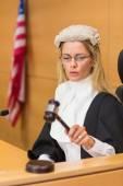 Stern judge sitting and listening — Stock Photo