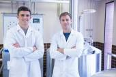 Portrait of scientists with arms crossed — Stock Photo