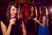 Pretty brunette drinking a cocktail — Stock Photo