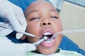 Boy having his teeth examined by dentist — Stock Photo
