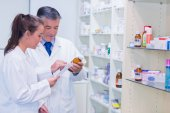 Pharmacist and trainee talking together — Stock Photo