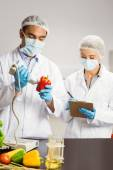 Food scientist using device on pepper — Stock Photo