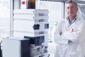 Scientist standing next to the machine — Stock Photo