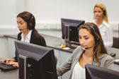 Call centre agents talking on the headset — Stock Photo