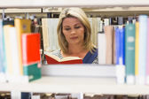 Mature student studying in the library — Stock Photo