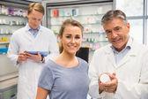 Happy customer talking with pharmacist — Stock Photo