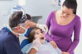 Dentist examining young patient — Stock Photo