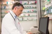 Focused pharmacist using the computer — Stock Photo