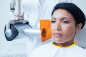 Serious young woman undergoing dental checkup — Stock Photo