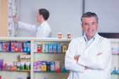 Pharmacist standing with arms crossed — Stock Photo