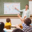 Teacher giving a geography lesson in classroom — Stock Photo #65535797