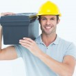 Happy worker carrying tool box on shoulder — Stock Photo #65535871