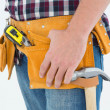 Male repairman wearing tool belt — Stock Photo #65536453