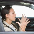 Young woman experiencing road rage — Stock Photo #65536489