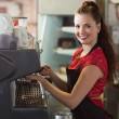 Barista making a cup of coffee — Stock Photo #65536839