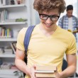 Students carrying small pile of books — Stock Photo #65537647