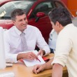 Salesman showing client where to sign deal — Stock Photo #65538097