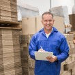 Warehouse worker checking his list — Stock Photo #65538175