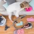 Woman cleaning her chaotic room — Stock Photo #65538461