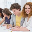 Fashion students taking notes in class — Stock Photo #65538517