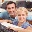 Cute pupil in computer class with teacher — Stock Photo #65538669
