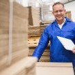 Warehouse worker checking his list — Stock Photo #65538731