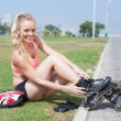 Fit blonde getting ready to roller blade — Stock Photo #65538785