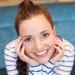 Young woman smiling at camera — Stock Photo #65539357