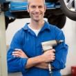Mechanic holding a drill tool — Stock Photo #65539511