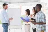 Man presenting and coworkers taking notes — Stock Photo