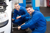 Team of mechanics working together — Stock Photo