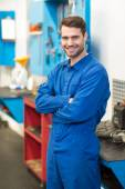 Mechanic smiling at the camera — Stock Photo