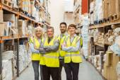Smiling warehouse team with arms crossed — Stock Photo