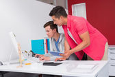 Students using computer and tablet together — Stock Photo
