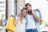 Couple looking at shopping purchases — Stock Photo