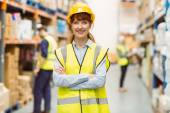 Warehouse manager smiling at camera with arms crossed — Stock Photo