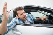 Young man experiencing road rage — Stock Photo