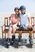 Couple getting ready to roller blade — Stock Photo