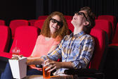 Young couple watching a 3d film — Photo