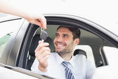 Businessman getting his new car key — Stock Photo