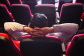 Young man with hands head watching a film — Stock Photo