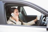 Woman drinking coffee while driving — Foto Stock