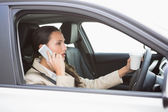 Woman drinking coffee while driving — Stock Photo